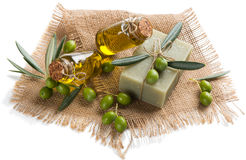 Green olives, soap with olive oil Stock Photos