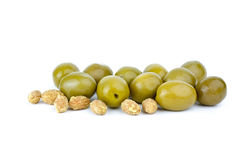 Green olives and some pits. Isolated on the white background stock photos