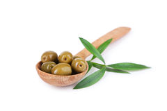 Green olives in spoon isolated on white background Stock Images