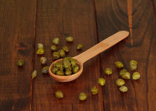 Green olives on the spoon Royalty Free Stock Photos