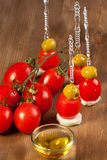 Green olives and tomato Stock Images