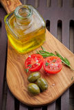 Green olives and tomatoes Stock Image