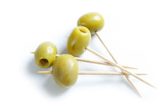 Green olives and toothpick Stock Photos
