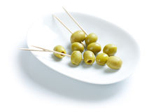 Green olives and toothpick Royalty Free Stock Image
