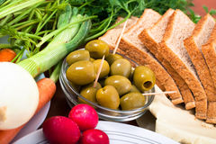Green olives, vegetable and bread Royalty Free Stock Images