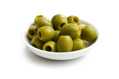 Green olives in white bowl Royalty Free Stock Images