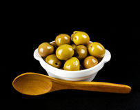 Green olives in a white bowl Royalty Free Stock Photos