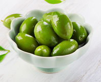 Green olives in  white bowl. Stock Images