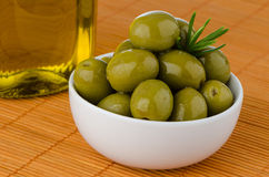 Green olives in a white ceramic Royalty Free Stock Photos
