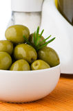 Green olives in a white ceramic Stock Photos