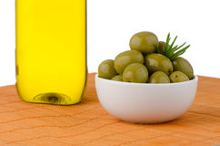 Green olives in a white ceramic Stock Photography