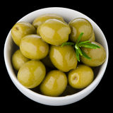 Green olives in a white ceramic Royalty Free Stock Photo