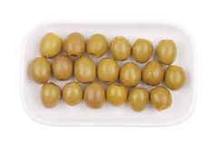 Green olives on a white plate Royalty Free Stock Images