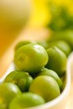 Green olives in white plate Royalty Free Stock Image