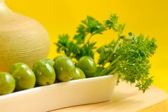 Green olives in white plate Stock Photography