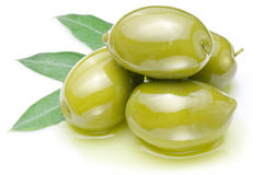 Green Olives With Leaves In Oil. Royalty Free Stock Photography