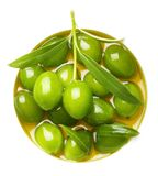 Green Olives With Leaves In Oil Royalty Free Stock Images