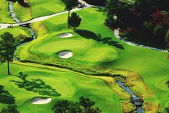 On the Green. One of Atlanta& x27;s golf course putting greens next to a stream Stock Images