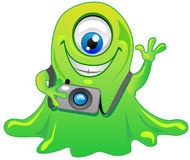 Green one eye slime alien monster Stock Images
