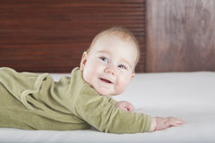 Green onesie baby smiling Royalty Free Stock Image