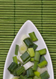 Green onion. Sliced green onion in a white kitchen bowl Royalty Free Stock Images