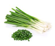 Green onion close-up isolated on a white background. Stock Photos