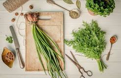 Green onion, dill on the cutting board, topshot Royalty Free Stock Image