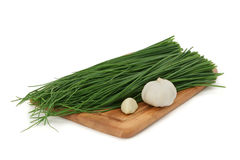 Green onion, garlic on a board Royalty Free Stock Images