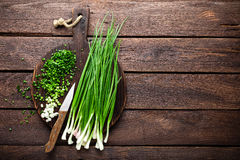 Green onion or scallion on wooden board, fresh spring chives Stock Photo