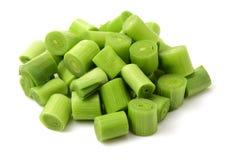 Green onion slice. On wodd background stock photography