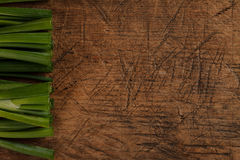 Green onion sticks on wooden table Stock Images