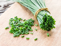 Green onion on the wood. Royalty Free Stock Images