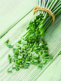 Green onion on the wood. Royalty Free Stock Image