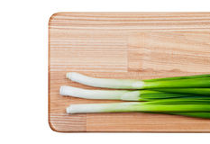 Green onions on cutting board. Royalty Free Stock Images