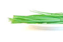 Green onions on white plate Royalty Free Stock Photography