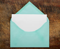 Green open envelope with blank paper. Royalty Free Stock Image