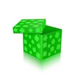 Green open gift box with shamrocks Stock Photo