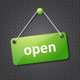 Green open hanging sign. On grey texture Stock Photo