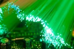 Green optical fibres on computer circuit board. Close up macro shot Royalty Free Stock Photos
