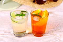 Green and orange cocktails with holiday background. Close up stock image