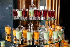 Green and orange cocktails stand on the bar Stock Photography