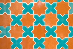 Green and orange color ceramic tile star shape Stock Images