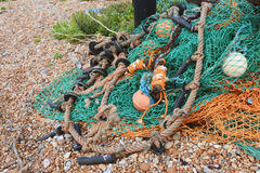 Green and orange fishing nets Stock Photos