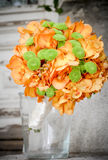 Green and orange. Floral arrangement for the bride or godfathers, godmothers Royalty Free Stock Photos