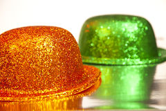 Green and orange hats Royalty Free Stock Photography