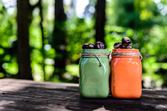 Green Orange Jars with chestnuts copyspace Royalty Free Stock Photos