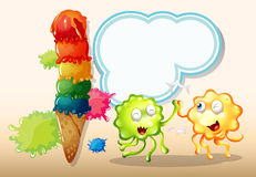 A green and an orange monster playing near the giant icecream Royalty Free Stock Image