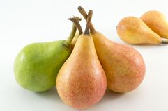 Green and orange pears on white backgrround Royalty Free Stock Image