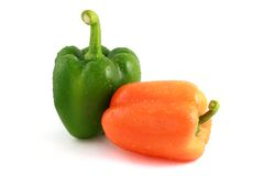 Green and orange peppers Royalty Free Stock Photography