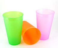 Green, orange and pink cups Stock Photos